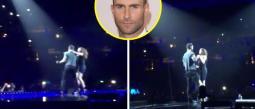 Adam Levine fue sorprendido por una fan en pleno escenario.