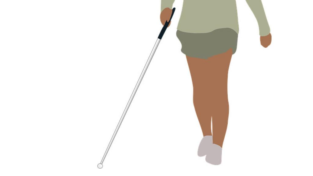 Niña le ayuda a su compañera ciega a utilizar bastón guía.